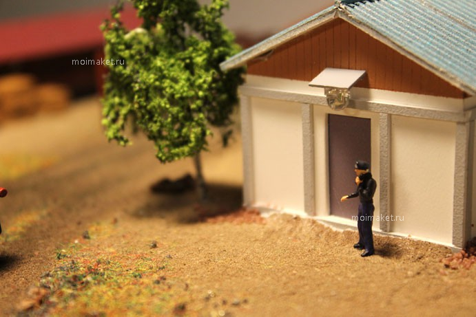 Tree and man near the house on the model