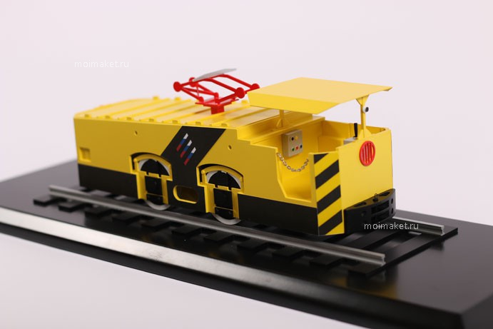Model of electric locomotive on the glossy breadboard