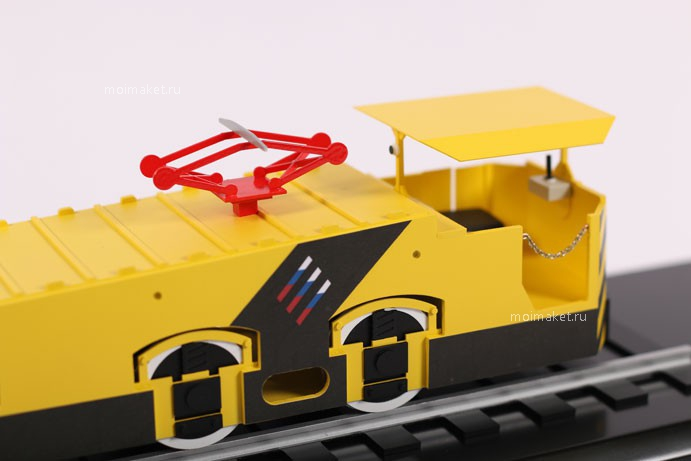 Red pantograph of electric locomotive model